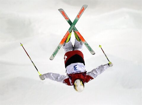 Canada's Chloe Dufour-Lapointe jumps during qualifying in the women's moguls at the Rosa Kutor Exreme Park ahead of the 2014 Winter Olympics, Thursday, Feb. 6, 2014, in Krasnaya Polyana, Russia. (AP Photo/Andy Wong)