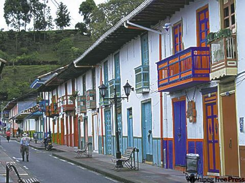 At left, street scene in old colonial Salento, nestled in the Andes Mountains near the Cocora  Valley.