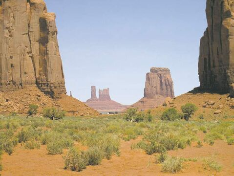 Towering rock outcrops dot the landscape at Monument Valley, along the Utah-Arizona border.