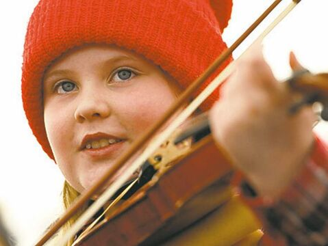 A young member of the Ensemble folklorique De la Rivière-Rouge performs Sunday.