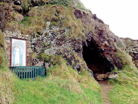 A hermit's home and a statue of Our Lady of Inishtrahull at Malin Well, a pilgrimage point at the northern tip of Ireland. Don't feel too bad for the hermit, as the views from his cave are spectacular.
