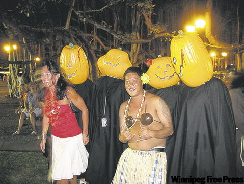 Pumpkin heads at a Halloween bash on Front Street in Lahaina.