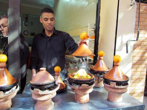 Tagines, or meat and vegetables stews, cooking in the historic medina of Marrakech.