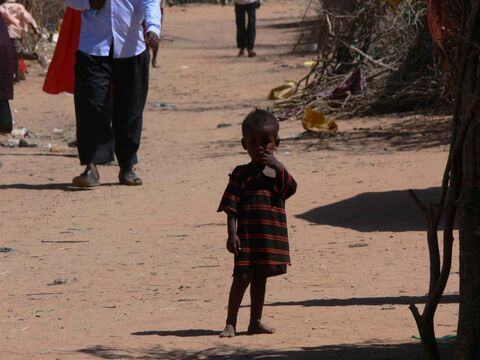 A child checks out a westerner in the Dagahaley refugee camp in Dadaab, Kenya.