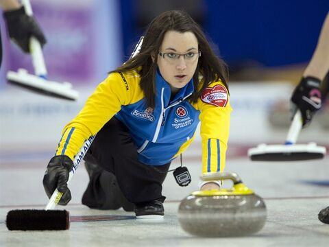 Alberta skip Val Sweeting takes a shot during her match against Quebec at the Scotties Tournament of Hearts draw fourteen curling action Thursday, February 6, 2014 in Montreal.THE CANADIAN PRESS/Ryan Remiorz