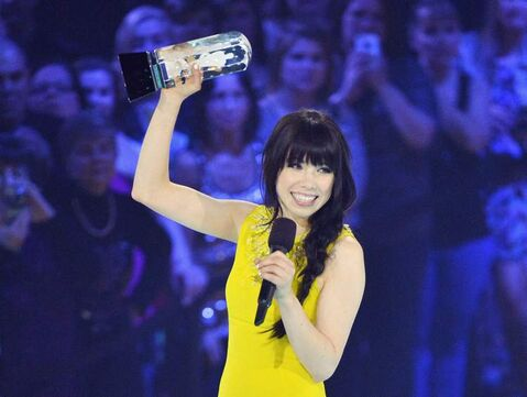 Carly Rae Jepsen receives the Juno for Album of the Year -- one of three she snagged during the 2013 Juno Awards in Regina on Sunday.