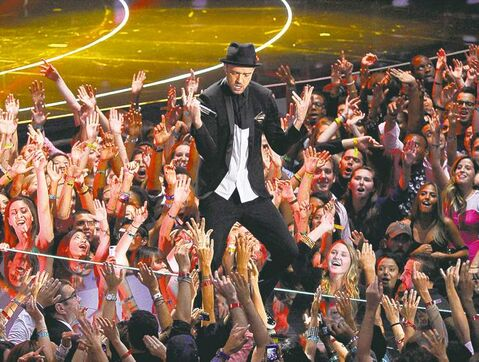 Justin Timberlake performs at the MTV Video Music Awards: 'I don't deserve the award, but I'm not going to give it back.'