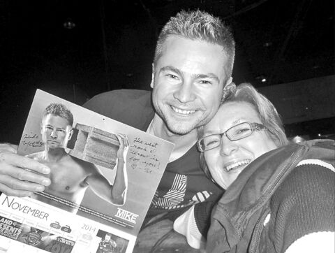 Mike McEwen and Donna Younger with McEwen's beefcake pic.