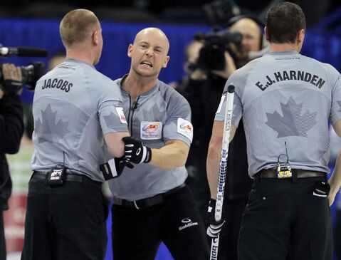 Ryan Fry (centre) has a similar intensity to teammates Brad Jacobs (left) and E.J. Harnden, as was evident after their win over Kevin Martin Thursday.