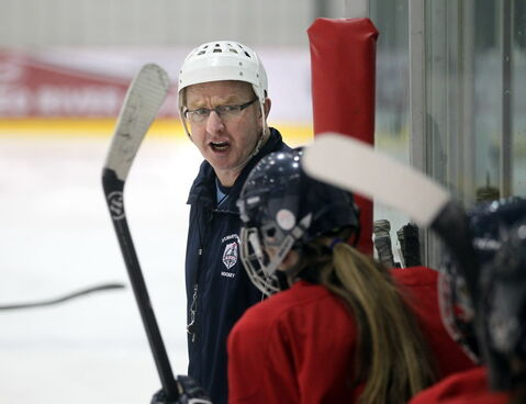 Larry Bumstead, coach of the host St. Mary's Academy Flames, works practice Monday.