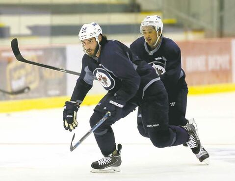 Chris Thornburn and new Jets winger Devon Setoguchi slash up the ice Friday in an informal practice at the MTS Iceplex.