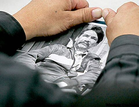A relative holds photo of Brian Sinclair.