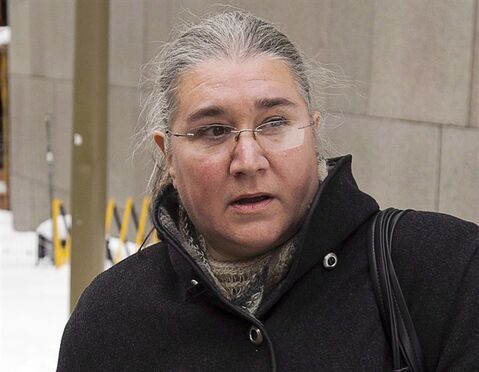Pamela Porter leaves court on December 19, 2013 in Montreal. THE CANADIAN PRESS/Ryan Remiorz