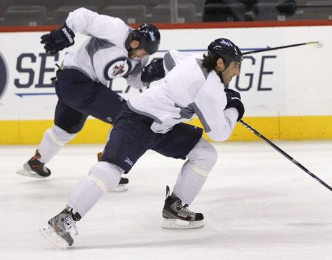 Winnipeg Jets wingers Chris Thorburn (right) and Anthony Peluso churn through a skating drill at Wednesday's practice.