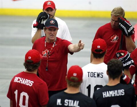 Head coach Mike Babcock gives instructions during a ball hockey training session at the Canadian national men's team orientation camp in Calgary, Alta., Tuesday, Aug. 27, 2013. From ball hockey to a gold medal, Team Canada put on a historic, dominant show at the Sochi Olympics. THE CANADIAN PRESS/Jeff McIntosh