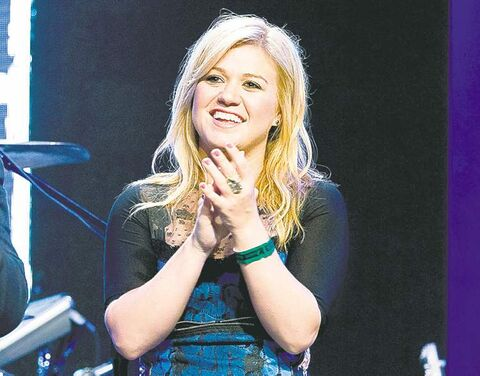 FILE - This Sept. 4, 2012 file photo shows singer Kelly Clarkson at the Pepsi NFL anthems kick off at Hard Rock Cafe in New York. Clarkson will ride as celebrity grand marshal when the Krewe of Endymion parade rolls on the Saturday before Mardi Gras in 2013. She was the first winner of the Fox reality show