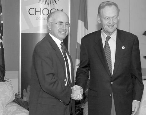 Jean Chr��tien (right) with Australian prime minister John Howard in 2002.