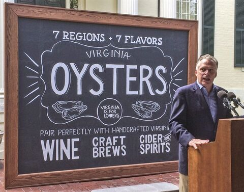 Virginia Gov. Terry McAuliffe announces the creation of the Virginia Oyster Trail on Tuesday, Aug. 19, 2014, at the Executive Mansion in Richmond, Va. The trail links visitors with Virginia oyster purveyors, and restaurants, raw bars and the long-standing watermen culture throughout the Northern Neck, Middle Peninsula and Virginia's Eastern Shore. The new tourism project comes as Virginia saw its oyster harvest increase 25 percent to more than 500,000 bushels in 2013, the largest harvest since 1987. (AP Photo/Michael Felberbaum)