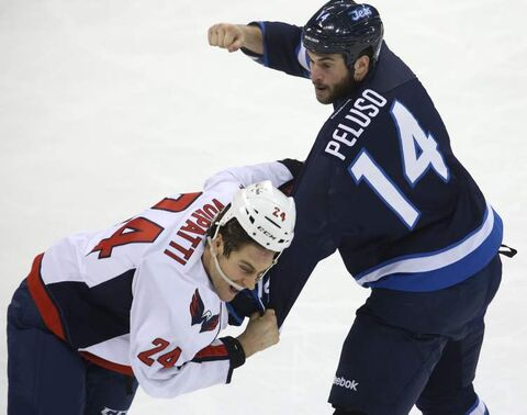 Winnipeg Jets' Anthony Peluso (14) fights with Washington Capitals' Aaron Volpatti (24) in March 2013.