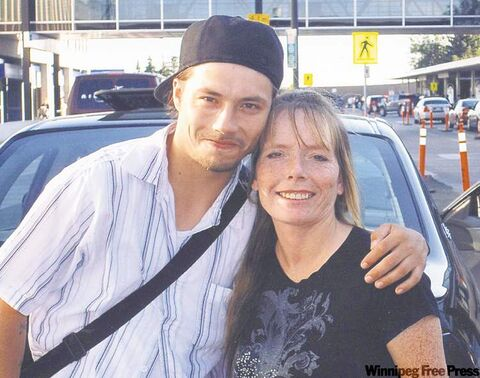 Homicide victim Steven Dodge is seen with his mother, Deborah Woodhouse, in 2010. Dodge was stabbed in the backyard of an Arlington Street home on June 26, 2011.
