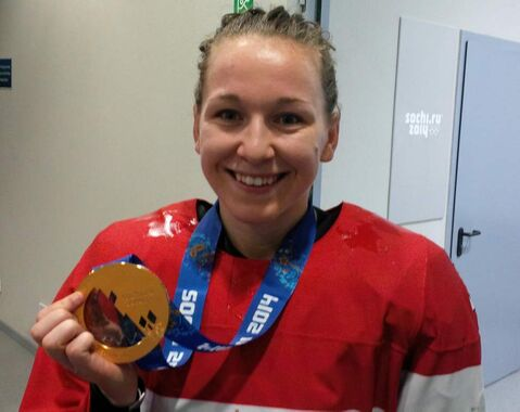 Jocelyne Larocque poses Thursday with her new gold medal.