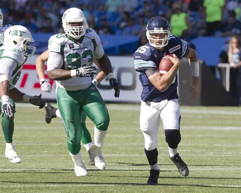 Toronto Argonauts quarterback Ricky Ray scrambles for a first down in the fourth quarter of their CFL game against the Saskatchewan Roughriders in Toronto on Saturday, July 5, 2014. Ray is the CFL offensive player of the week after leading Toronto to a win in its home opener. THE CANADIAN PRESS/Fred Thornhill