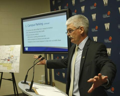 Winnipeg Blue Bombers vice-president and COO Jim Bell unveils the new Event Day website and nine-point transportation and parking plan for Investors Group Field at a news conference Tuesday.