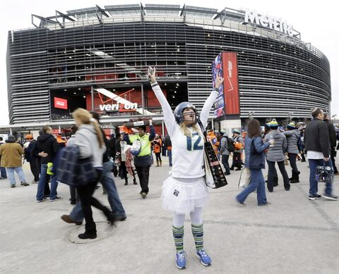 Lacey Surprenat of Seattle cheers outside MetLife Stadium before the NFL Super Bowl XLVIII football game Sunday, Feb. 2, 2014, in East Rutherford, N.J. (AP Photo/Julio Cortez)