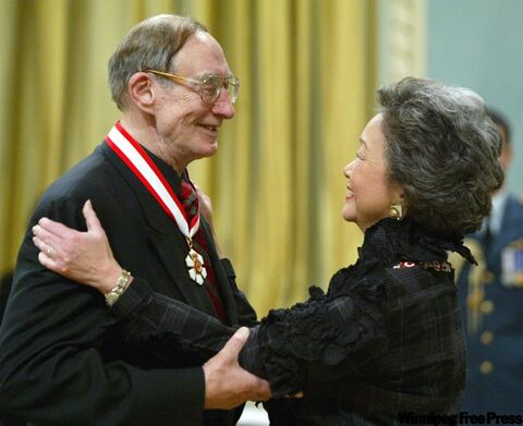 Former Gov. Gen. Adrienne Clarkson presents Arnold Spohr with the Order of Canada during a ceremony at Rideau Hall in Ottawa on May 14, 2004.
