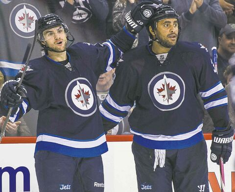 Jets Michael Frolik (67) and Dustin  Byfuglien  celebrates Frolik's second period goal.