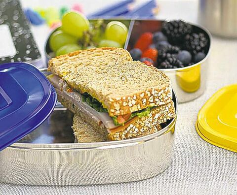Multi-compartment divided containers make it easy to pack sandwiches and fruit as shown here.