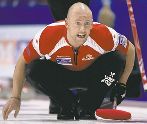 Canada third, Ryan Fry watches his shot during an afternoon draw against Switzerland at the World Men's Curling Championship in Victoria, B.C. Monday, April 1, 2013. THE CANADIAN PRESS/Jonathan Hayward