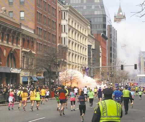 Runners and spectators still haven't had time to react after one of two explosions goes off near the Boston Marathon finish line.