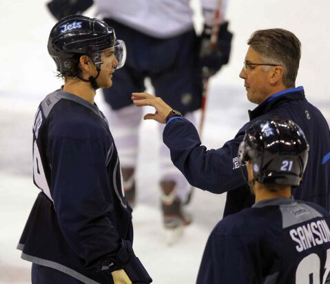 Jim Slater talks to head coach Claude Noel at a Friday workout. Slater was none too pleased with Thursday's performance against the Wild.
