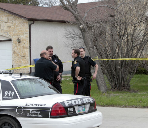 Winnipeg police outside of a home in the 4000 block of Roblin Boulevard this morning.