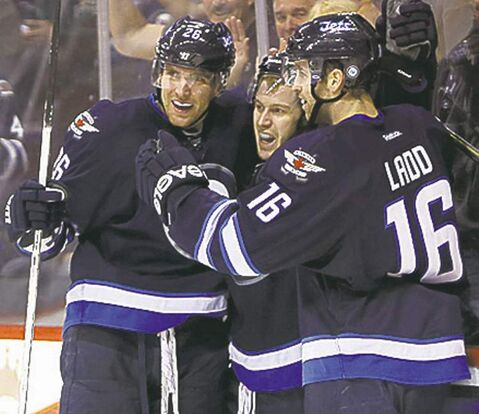 Winnipeg Jets' Blake Wheeler (26), Bryan Little (18) and Andrew Ladd (16) celebrate after Little scored during second period NHL hockey action against the Philadelphia Flyers at MTS Centre in Winnipeg, Saturday, April 6, 2013. (TREVOR HAGAN/WINNIPEG FREE PRESS)