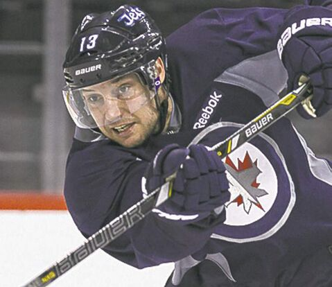 Winnipeg Jets' Kyle Wellwood (13) during practice at MTS Centre Wednesday morning.  130417 April 17, 2013 Mike Deal / Winnipeg Free Press