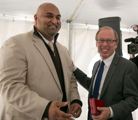 Fortress Real Developments Inc. president and CEO Jawad Rathore (left) with Mayor Sam Katz after Wednesday's announcement.