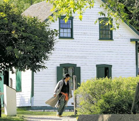 Interpreter Quillan Daniel walks outside Riel House, Louis Riel's mother's home, where the Manitoba founder lay in state after his death.