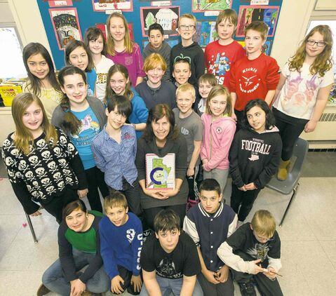 Brock Corydon School's grades 5 and 6 students, with teacher Susan Pereles, like a lot of things about Winnipeg. Pereles holds a book they created about many of them.