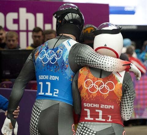 Canada's Samuel Edney (left) places his arm around teammate Alex Gough following their teams fourth place finish in the Luge Team Relay at the Sochi Winter Olympics in Krasnaya Polyana, Russia, Thursday, Feb. 13, 2014. THE CANADIAN PRESS/Jonathan Hayward