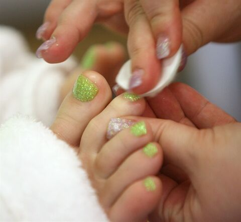 A beautician performs a pedicure on a client in Boise, Idaho, Feb. 20, 2009. With sandal season finally upon us the instinct to pretty up your cracked heels, leathery soles and unpainted toes is a natural one. And with the proliferation of inexpensive nail bars in recent years, pedicures are within reach, pricewise, for a lot of people.THE CANADIAN PRESS/AP, Joe Jaszewski
