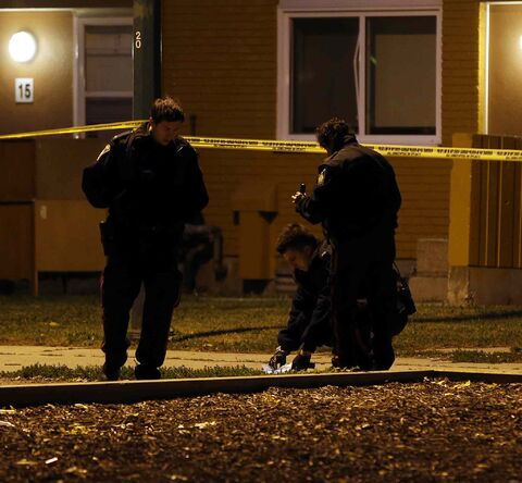 Police investigate at the scene of a fight that resulted in the death of Phillepp Rick George Amos.