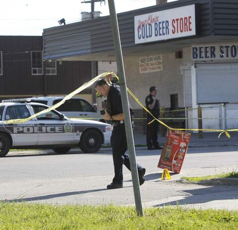 Winnipeg Police have three sections of sidewalk taped off near the Balmoral Hotel's beer store on Cumberland Avenue at Kennedy Street Tuesday morning.