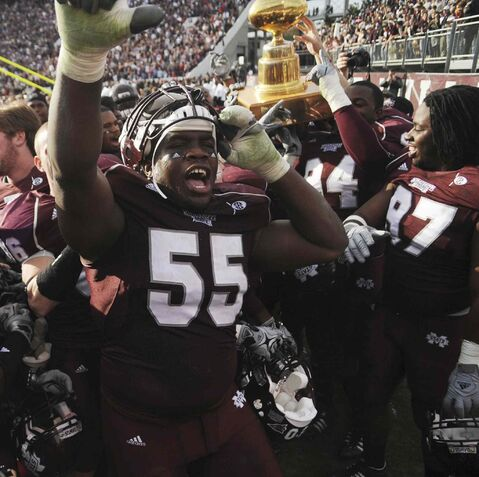Mississippi State's Quentin Saulsberry (55) celebrates his team's 41-27 win over Mississippi after a 2009 NCAA college football game in Starkville, Miss.