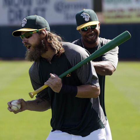 Oakland Athletics' Josh Reddick. (left)