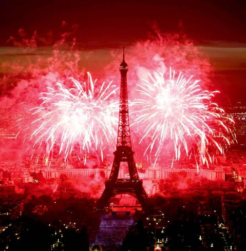 Fireworks illuminate the Eiffel Tower in Paris during Bastille Day celebrations.