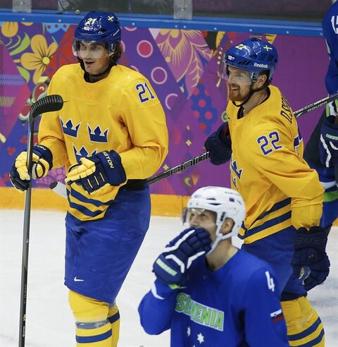Sweden forward Loui Eriksson and forward Daniel Sedin react after a third period goal by Eriksson against Slovenia during a men's quarterfinal ice hockey game at the 2014 Winter Olympics, Wednesday, Feb. 19, 2014, in Sochi, Russia. (AP Photo/Mark Humphrey)