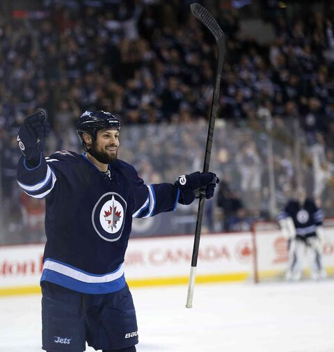 Winnipeg Jets' Zach Bogosian (44) celebrates after he scored against the Toronto Maple Leafs during the second period of Saturday's NHL hockey game at Winnipeg's MTS Centre.