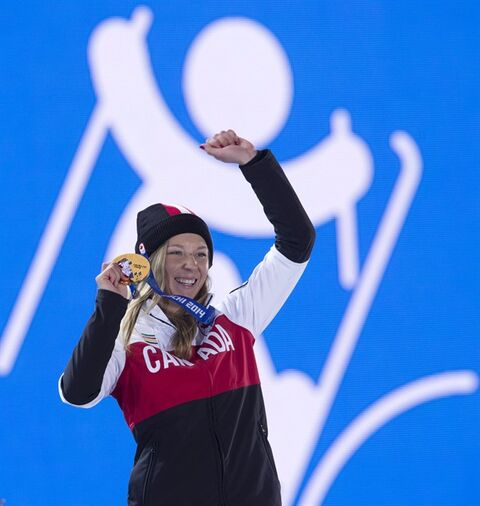 Canada's Ski Slopestyle gold medallist Dara Howell celebrates with her gold medal during a ceremony at the Sochi Winter Olympics on Tuesday, February 11, 2014, in Sochi, Russia. THE CANADIAN PRESS/Adrian Wyld